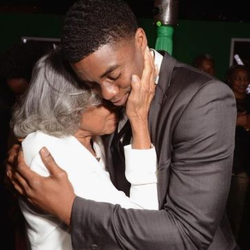 Rachel Robinson hugging Chadwick Boseman who played Jackie Robinson in 42.